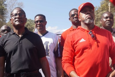 MCP leader Lazarous Chakwera (in black) and UTM leader Saulos Chilima (in red) were also taking part in protests against last May election results (file photo).