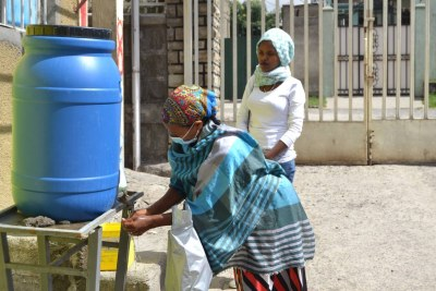 Community health workers at a handwashing station at a healthcare center in Addis Ababa, Ethiopia, April 1, 2020.