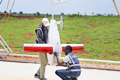 Rwandan engineers remove parts of a drone at Zipline's Kayonza distribution centre (file photo).