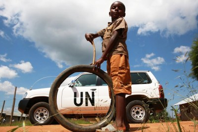 A child plays near a UN vehicle in 2014 in Beni in North Kivu province, where issues of fraud have become magnified since 2018 due to an Ebola outbreak.