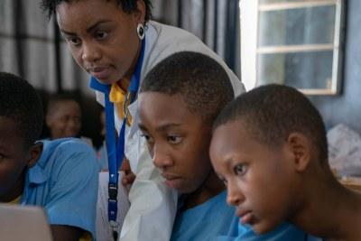 A teacher in class in Rwanda as part of Mastercard Foundation's Leaders in Teaching program.