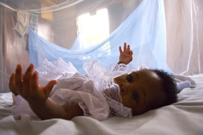An infant surrounded by a protective mosquito net in Ghana (file photo).