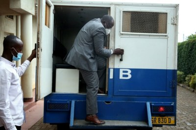 Former prime minister, Pierre Damien Habumuremyi being taken to court.