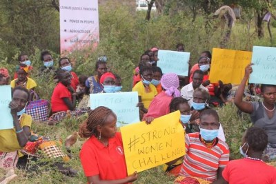 Women from Mokutani in Tiaty East Sub-county hold placards to relay anti-GBV messages as part of a celebration to mark 16 Days of Activism against violence (file photo).