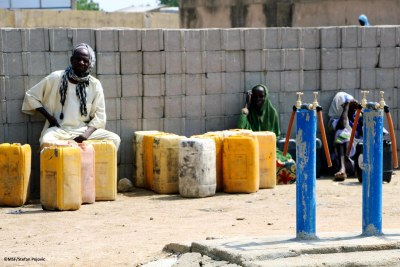 A man waits patiently for his turn to get clean water from a water point in Pulka. Borno state, Nigeria, February 2021.