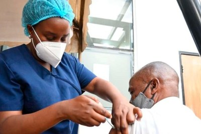A medic administers a Covid-19 vaccine at the Kenya Medical Practitioners and Dentists Council headquarters in Nairobi on March 31.