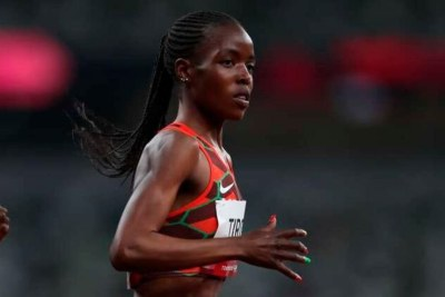 Kenya's Agnes Jebet Tirop, right, competes in the Women's 5,000m race heats during the Tokyo 2020 Olympic Games at the Olympic Stadium in Tokyo on July 30, 2021.